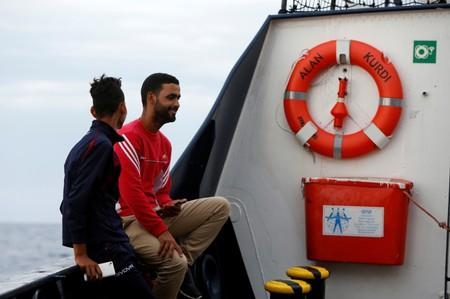 Tunisian migrants react on the German NGO Sea-Eye migrant rescue ship 'Alan Kurdi' after they were informed they would disembark in Malta, in international waters off Malta in the central Mediterranean Sea
