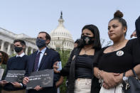 """Lupe Guillén, second from right, and Gloria Guillén, right, Vanessa Guillén's sister and mother, listen during a news conference about the """"I Am Vanessa Guillén Act,"""" in honor of the late U.S. Army Specialist Vanessa Guillén, and survivors of military sexual violence, during a news conference on Capitol Hill, Wednesday, Sept. 16, 2020, in Washington. (AP Photo/Alex Brandon)"""
