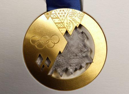 The gold medal for the 2014 Winter Olympic Games in Sochi is seen on display during a presentation in St. Petersburg May 30, 2013. REUTERS/Alexander Demianchuk/File Photo