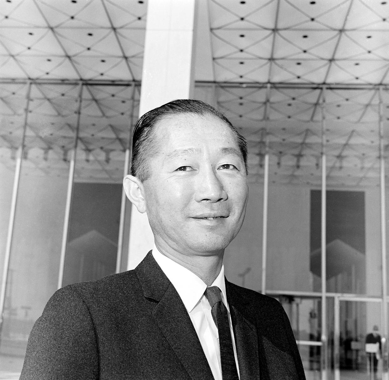 Architect Minoru Yamasaki of Birmingham, Mich., stands in front of the Michigan Consolidated Gas Co., building in Detroit, Mich., on March 23, 1964. (AP)
