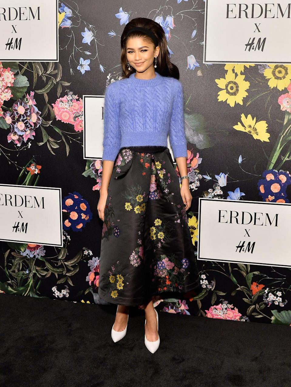 <p>For the Erdem x H&M Runway Show, she sported the collection with a playful '60s look. Can't get enough of this knit sweater and floral skirt sitch!</p>
