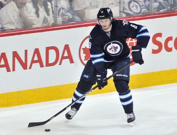 WINNIPEG, CANADA - APRIL 22: Jacob Trouba #8 of the Winnipeg Jets plays the puck during second period action against the Anaheim Ducks in Game Four of the Western Conference Quarterfinals during the 2015 NHL Stanley Cup Playoffs on April 22, 2015 at the MTS Centre in Winnipeg, Manitoba, Canada. The Ducks defeated the Jets 5-2. (Photo by Lance Thomson/NHLI via Getty Images)