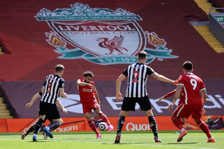 Mohamed Salah (2L) puts Liverpool ahead in a 1-1 draw against Newcastle United at Anfield