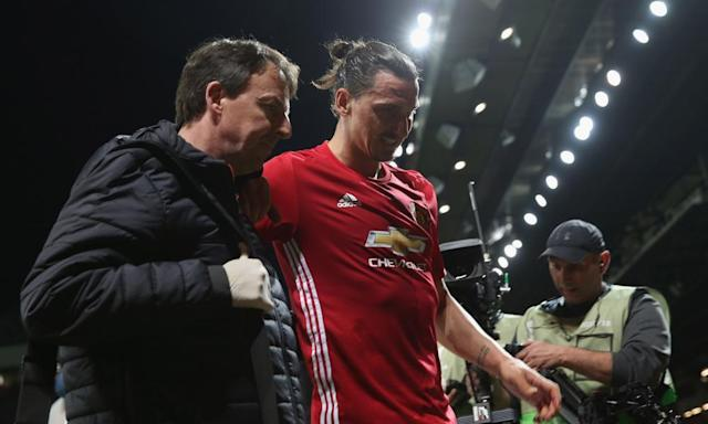 """<span class=""""element-image__caption"""">Zlatan Ibrahimovic hobbles off after suffering a serious-looking knee injury.</span> <span class=""""element-image__credit"""">Photograph: John Peters/Man Utd via Getty Images</span>"""