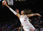 Phoenix Mercury center Brittney Griner (42) shoots next to Las Vegas Aces center Liz Cambage, obscured, during the first half of Game 5 of a WNBA basketball playoff series Friday, Oct. 8, 2021, in Las Vegas. (AP Photo/Chase Stevens)