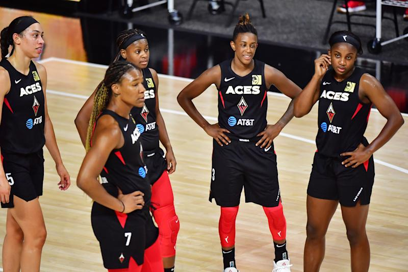 PALMETTO, FLORIDA - JULY 29: Las Vegas Aces look on during a stoppage in time in the second half of a game against the Atlanta Dream at Feld Entertainment Center on July 29, 2020 in Palmetto, Florida. (Photo by Julio Aguilar/Getty Images)
