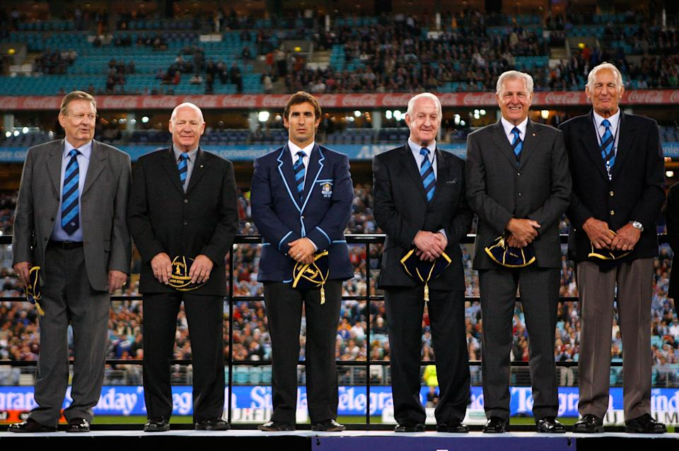 Bob Fulton (pictured second left) on stage after being inducted into the NSW Team of the Century before match one of the State of Origin series in 2008.