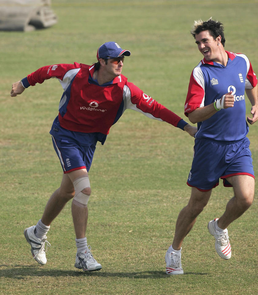 FAISALABAD, PAKISTAN - NOVEMBER 19: England batsman Kevin Pietersen has his shirt pulled by Michael Vaughan during an England practice session at Iqbal Faisalabad Cricket Stadium on November 19, 2005 in Faisalabad, Pakistan. (Photo by Stu Forster/Getty Images)