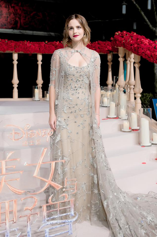 <p>The British actress gave off regal vibes with this caped Elie Saab gown, resulting in a true fairytale look. <i>[Photo: Rex]</i> </p>