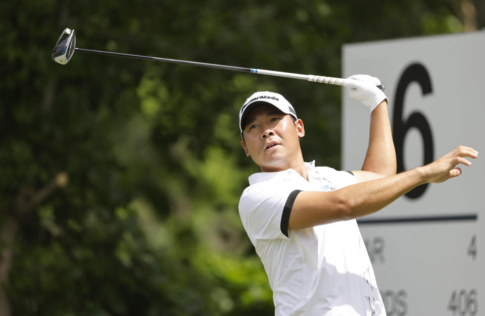 Xinjun Zhang plays his shot from the sixth tee during the first round of the Charles Schwab Challenge golf tournament at the Colonial Country Club in Fort Worth, Texas, Thursday, May 27, 2021. (AP Photo/Ron Jenkins)