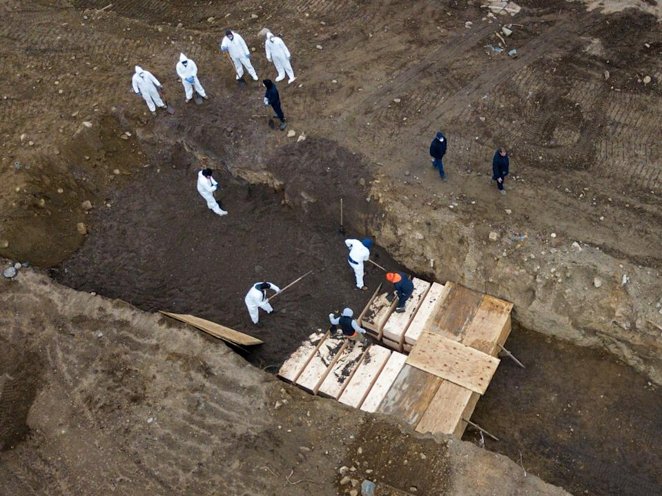 """Drone pictures show bodies being buried on New York's Hart Island, where the department of corrections was dealing with more burials overall amid the coronavirus outbreak in New York City, April 9, 2020. <p class=""""copyright""""><a href=""""https://www.reutersconnect.com/all?id=tag%3Areuters.com%2C2020%3Anewsml_RC241G91KIPT&share=true"""" rel=""""nofollow noopener"""" target=""""_blank"""" data-ylk=""""slk:Lucas Jackson/Reuters"""" class=""""link rapid-noclick-resp"""">Lucas Jackson/Reuters</a></p>"""
