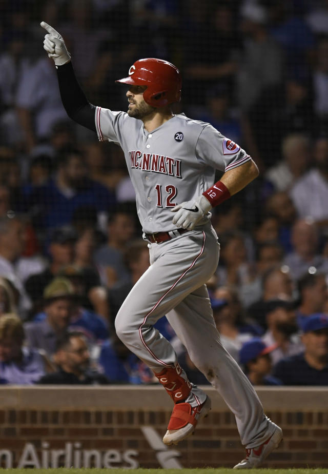Cincinnati Reds' Curt Casali celebrates after hitting a solo home run during the seventh inning of a baseball game against the Chicago Cubs, Monday, July 15, 2019, in Chicago. (AP Photo/Paul Beaty)