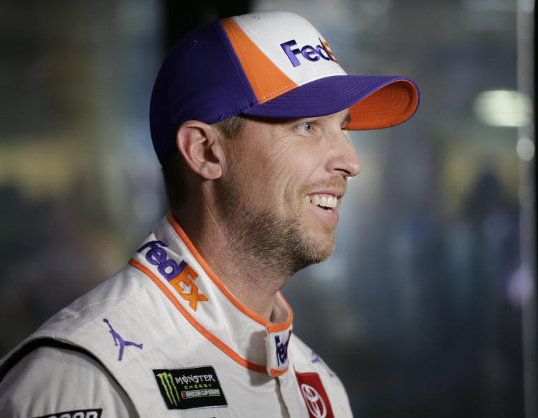 Denny Hamlin waits in the garage for a NASCAR Cup Series auto race practice to begin on Friday, Nov. 15, 2019, at Homestead-Miami Speedway in Homestead, Fla. Hamlin is one of four drivers racing for the series championship. (AP Photo/Terry Renna)