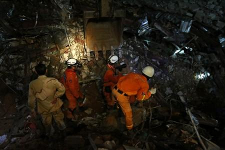 A rescue team attempts to find the missing workers at a collapsed building in Sihanoukville