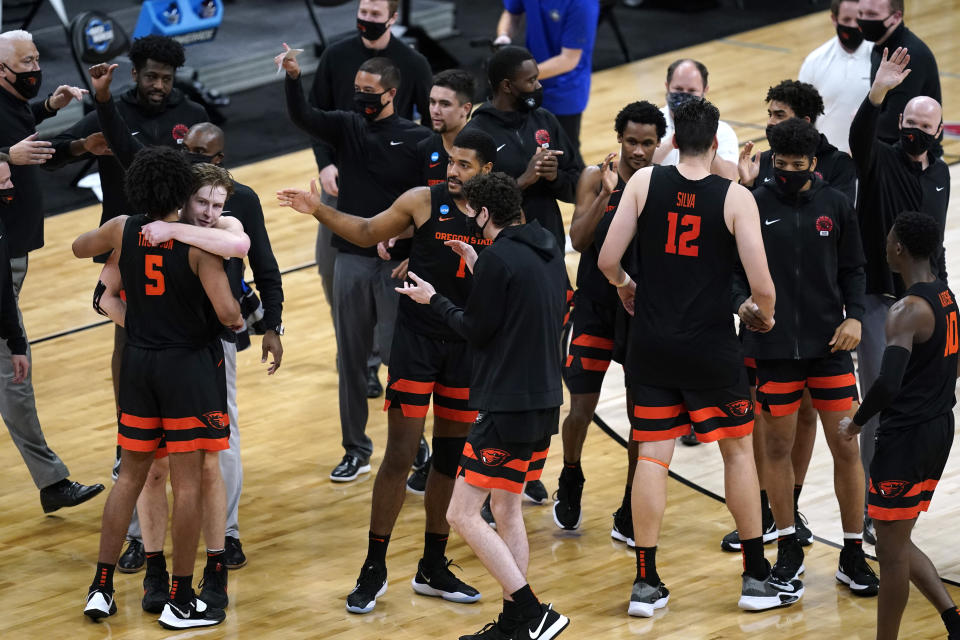 Oregon State players celebrate after a Sweet 16 game against Loyola Chicago in the NCAA men's college basketball tournament at Bankers Life Fieldhouse, Saturday, March 27, 2021, in Indianapolis. Oregon State won 65-58. (AP Photo/Darron Cummings)