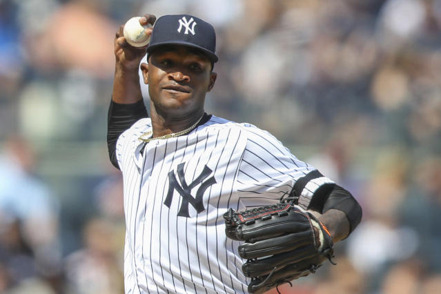 """FILE - This is an Aug. 31, 2019, file photo showing New York Yankees pitcher Domingo German throwing to first in a pickoff attempt during the fifth inning of a baseball game against the Oakland Athletics, in New York. Yankees star pitcher Domingo Germán has been placed on administrative leave by Major League Baseball because of domestic violence. MLB did not give details in its statement Thursday, Sept. 19, 2019, but said the leave """"may last up to seven days, barring an extension."""" (AP Photo/Mary Altaffer, File)"""