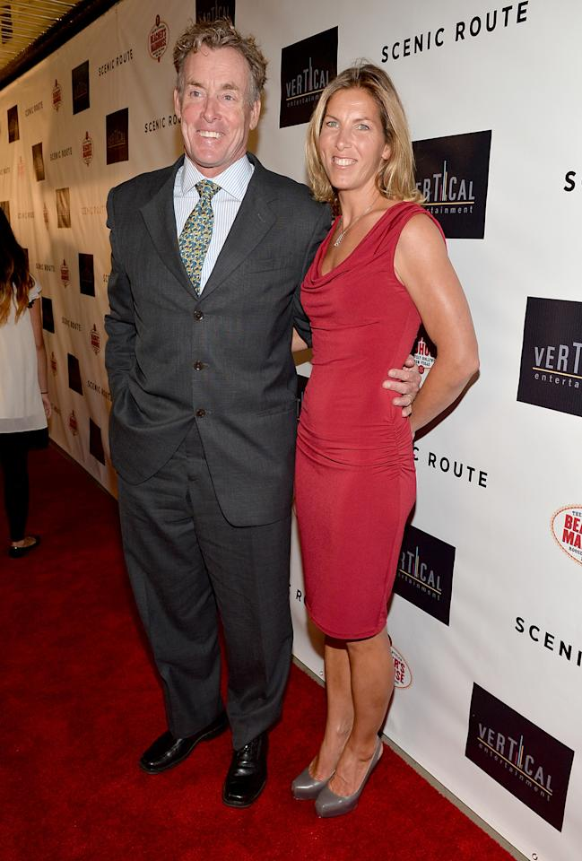 """HOLLYWOOD, CA - AUGUST 20:  Actor John C. McGinley (L) and Nichole McGinley arrive at the premiere of Vertical Entertainment's """"Scenic Route"""" at Chinese 6 Theater- Hollywood on August 20, 2013 in Hollywood, California.  (Photo by Alberto E. Rodriguez/Getty Images)"""