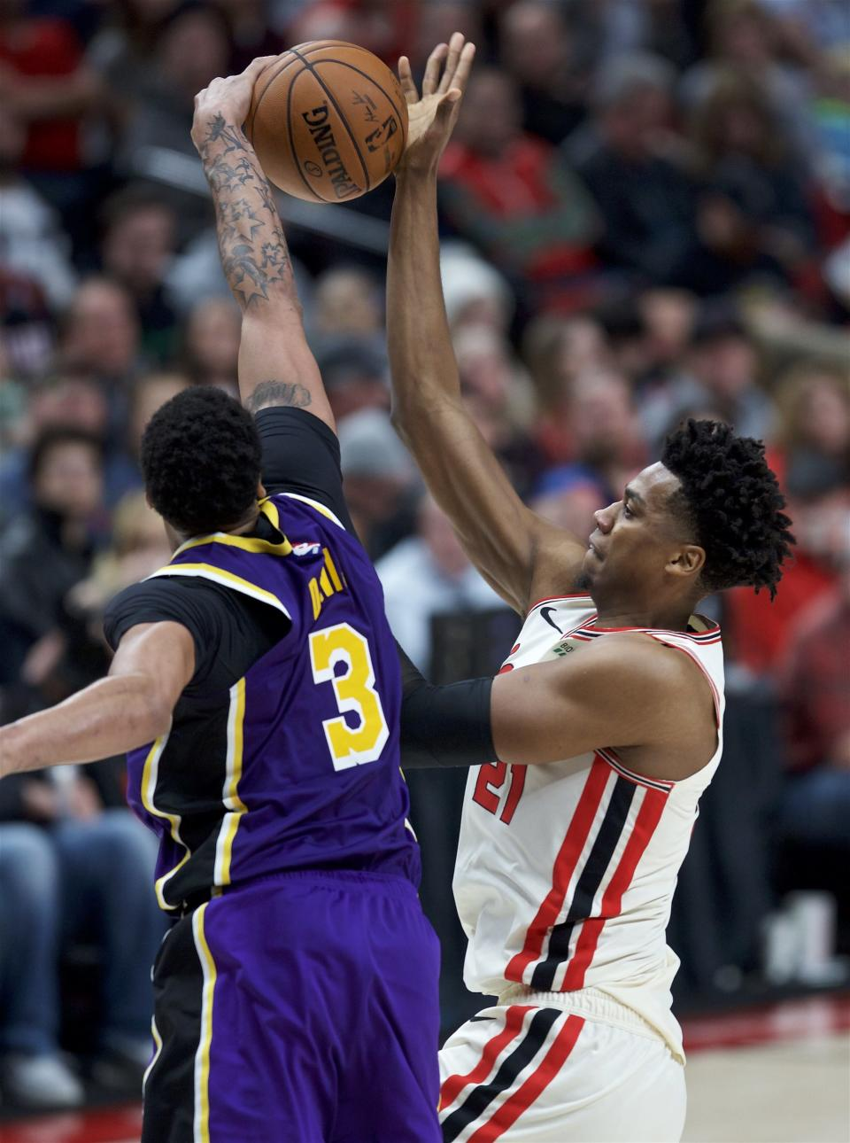 Portland Trail Blazers center Hassan Whiteside, right, has a shot blocked by Los Angeles Lakers forward Anthony Davis during the second half of an NBA basketball game in Portland, Ore., Friday, Dec. 6, 2019. (AP Photo/Craig Mitchelldyer)