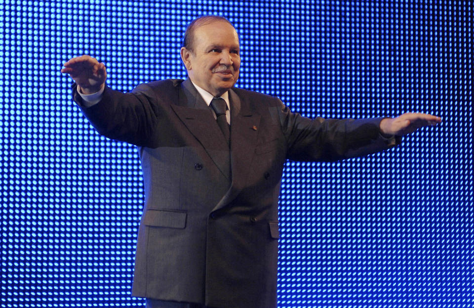 FILE - In this Feb.12 2009, file photo, Algerian President Abdelaziz Bouteflika waves during a rally in Algiers. Former Algerian President Bouteflika, who fought for independence from France in the 1950s and 1960s and was ousted amid pro-democracy protests in 2019 after 20 years in power, has died at age 84, state television announced Friday, Sept. 17, 2021. (AP Photo/Sidali Djarboub, File)