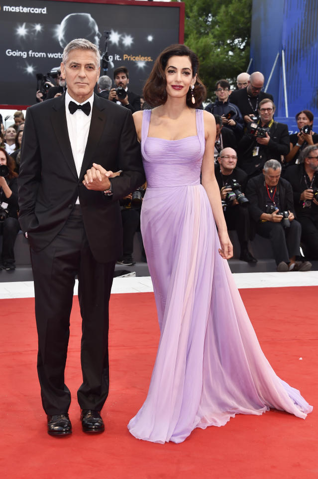 <p>Amal Clooney wowed the crowd in a lilac gown by Atelier Versace alongside husband, George, at the 74th Annual Venice Film Festival. Clooney traded her signature brown flowing locks in favour of a faux-bob style that radiated old Hollywood glamour. </p>