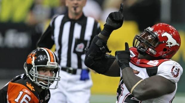 Labinjo, right, celebrates a sack in 2009.