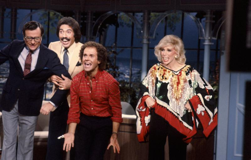 Comedian Mark Russell, musical guest Tony Orlando, fitness expert Richard Simmons and Joan Rivers (Paul Drinkwater/NBC/NBCU Photo Bank via Getty Images)