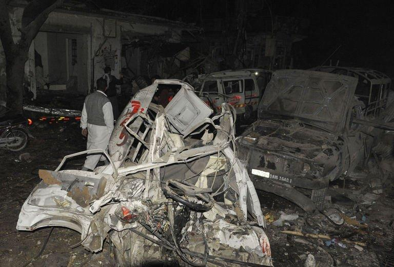 Destroyed vehicles remain at the site of a bomb attack in Quetta on January 10, 2013