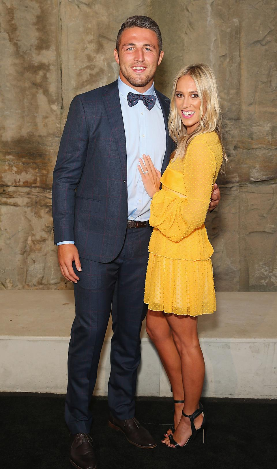 Sam Burgess and Phoebe Burgess at an event