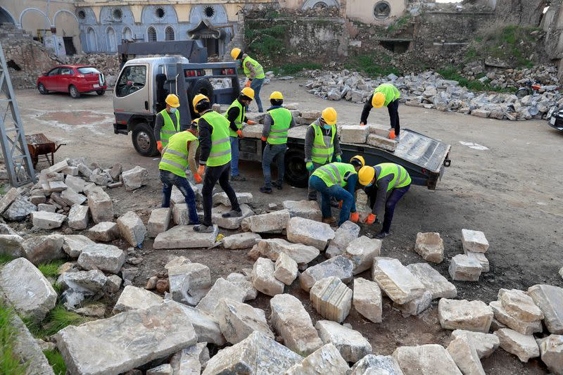 UNESCO workers transport pieces of marble from near 'Hosh al-Bieaa' (Church square) in Mosul