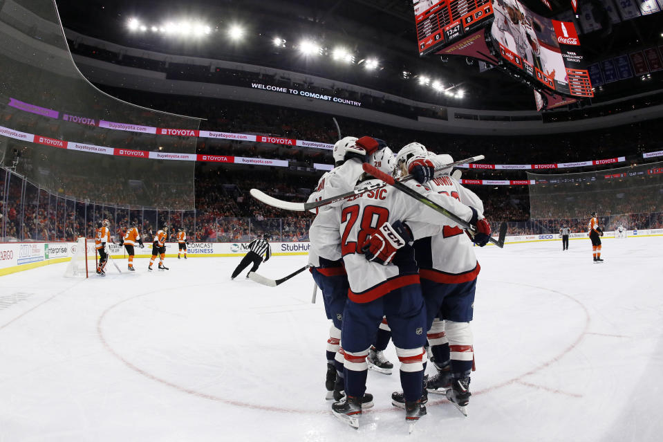 Washington Capitals' Brendan Leipsic (28) celebrates with his teammates after scoring a goal during the first period of an NHL hockey game against the Philadelphia Flyers, Wednesday, Nov. 13, 2019, in Philadelphia. (AP Photo/Matt Slocum)