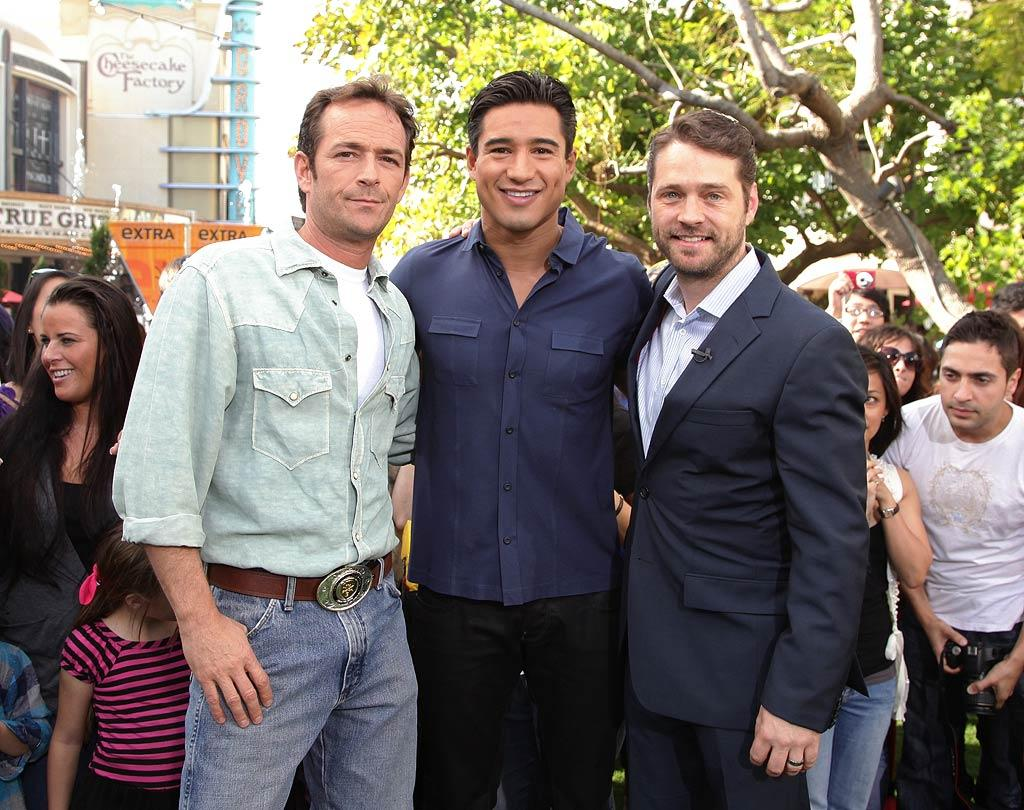 """Do you remember back in 1990 when """"Beverly Hills, 90210"""" stars Luke Perry and Jason Priestley were the most crush-worthy guys on TV? The BFFs reunited to film an appearance on """"Extra"""" at The Grove in Los Angeles with Mario Lopez Wednesday to promote their new film for the Hallmark Movie Channel, """"Goodnight for Justice."""" Noel Vasquez/<a href=""""http://www.gettyimages.com/"""" target=""""new"""">GettyImages.com</a> - January 19, 2011"""