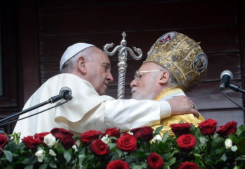 Pope Francis met Patriarch Bartholomew -- the ecumenical head of the Eastern Orthodox church -- during a 2014 visit to Istanbul (AFP Photo/Bulent Kilic)