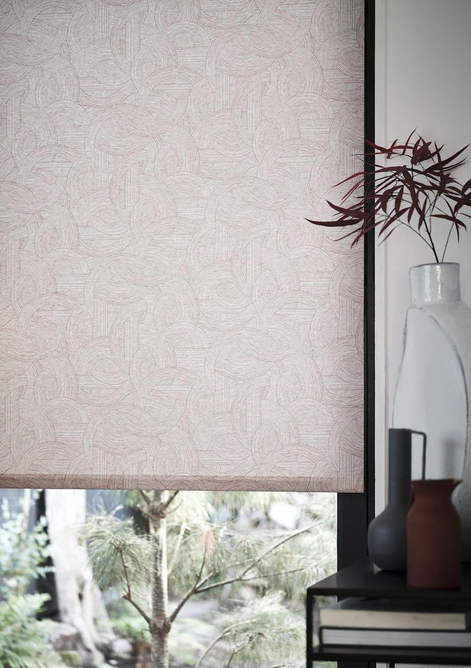 "<p>Crafted on a semi-linen base cloth, Breeze Russet features an abstract pattern of interlinking straight and curved lines. Adding a beautiful serene feel to your room, this deep, earthy tone can warm up even the coldest of interiors.</p><p><a class=""link rapid-noclick-resp"" href=""https://www.hillarys.co.uk/products/breeze-russet-roller-blind/"" rel=""nofollow noopener"" target=""_blank"" data-ylk=""slk:Order a sample and request an appointment"">Order a sample and request an appointment</a></p>"