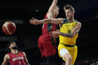 Australia's Nathan Sobey (9) drives to the basket past Germany's Niels Giffey (5) during a men's basketball preliminary round game at the 2020 Summer Olympics, Saturday, July 31, 2021, in Saitama, Japan. (AP Photo/Eric Gay)