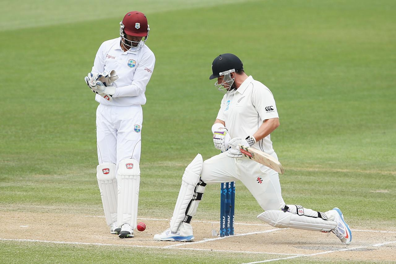 HAMILTON, NEW ZEALAND - DECEMBER 22:  Hamish Rutherford of New Zealand kicks the ball away from his stumps during day four of the Third Test match between New Zealand and the West Indies at Seddon Park on December 22, 2013 in Hamilton, New Zealand.  (Photo by Hannah Johnston/Getty Images)