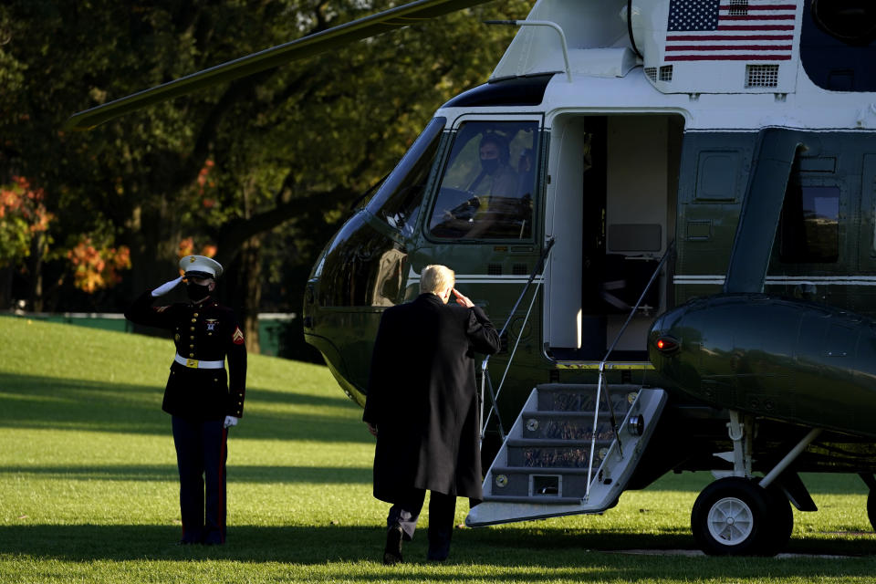 President Donald Trump salutes as he boards Marine One on the South Lawn of the White House, Wednesday, Oct. 21, 2020, in Washington. Trump is en route to North Carolina. (AP Photo/Alex Brandon)