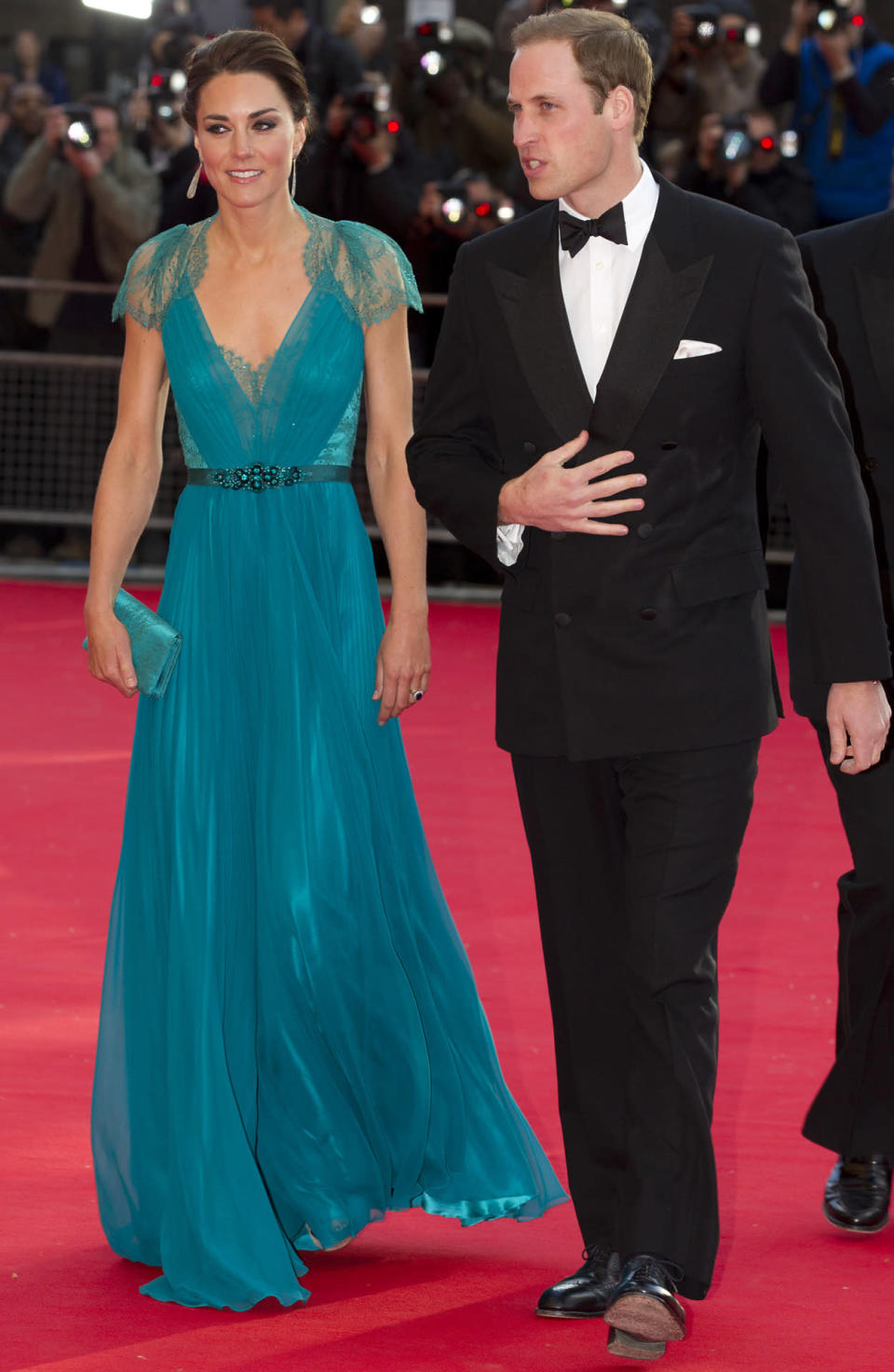 <p>Kate stunned in an emerald chiffon Jenny Packham gown with a lace back for a gala dinner. She carried a matching clutch and finished with glittering Jimmy Choo sandals. </p><p><i>[Photo: PA]</i></p>
