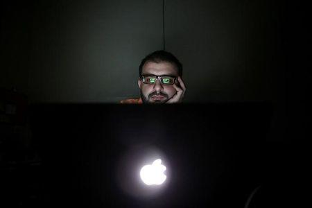 Director Humam Husari edits his film after finishing the filming phase at his office in the rebel held Douma neighbourhood of Damascus, Syria October 5, 2016. REUTERS/Bassam Khabieh