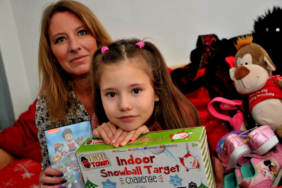 """Phoebe Greening and her mum Marsha. See SWNS story SWBRpresents Generous Phoebe Greening was so moved by seeing the plight of children in Africa that she plans to give away her Christmas presents. The eight-year-old made the decision after seeing an advert for Save the Children on TV. There and then she decided she wanted to act to help make a difference. Phoebe said: """"I was watching the TV with my mum and then the advert played."""