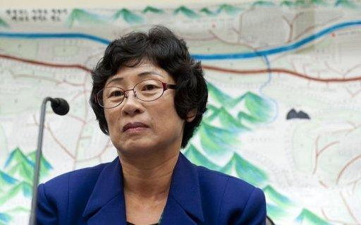 Kim Hye Sook, who spent 28 years in a North Korean prison camp (map behind) and the the longest serving survivor of the camps, testifies on her experiences before the House Foreign Affairs Subcommitee on Africa, Global Health, and Human Rights during a hearing on human rights in North Korea, on Capitol Hill in Washington