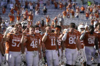 "Texas players, including Texas' Sam Ehlinger (11) sing ""The Eyes of Texas"" after an NCAA college football game against West Virginia in Austin, Texas, Saturday, Nov. 7, 2020. (AP Photo/Chuck Burton)"
