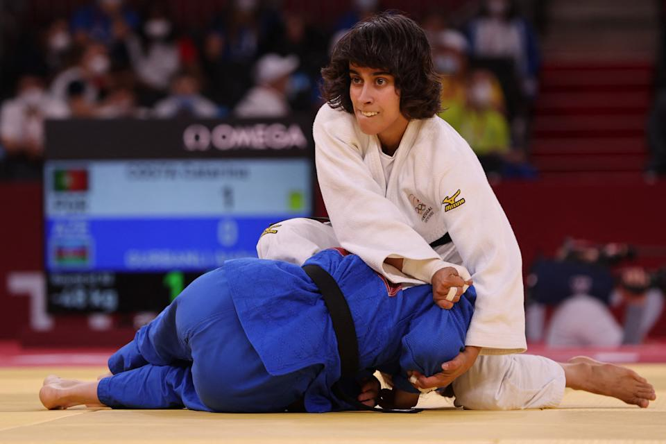 Portugal's Catarina Costa (white) competes with Azerbaijan's Aisha Gurbanli during their judo women's -48kg elimination round bout during the Tokyo 2020 Olympic Games at the Nippon Budokan in Tokyo on July 24, 2021. (Photo by Jack GUEZ / AFP) (Photo by JACK GUEZ/AFP via Getty Images)