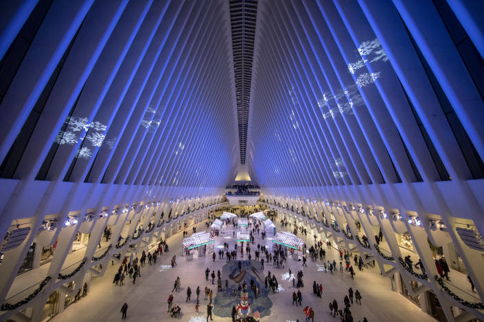 Colored lights reflect off the ceiling of the Oculus, part of the <span>World Trade Center Transportation Hub </span>in lower Manhattan. (Photo: Gordon Donovan/Yahoo News)
