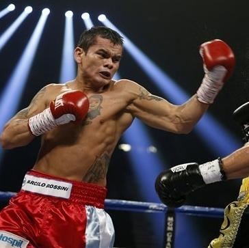 Marcos Maidana, of Argentina, left, punches Jesus Soto Karass, of Mexico, during a welterweight boxing match on Saturday, Sept. 15, 2012, in Las Vegas. Maidana won the match. (AP Photo/Isaac Brekken)