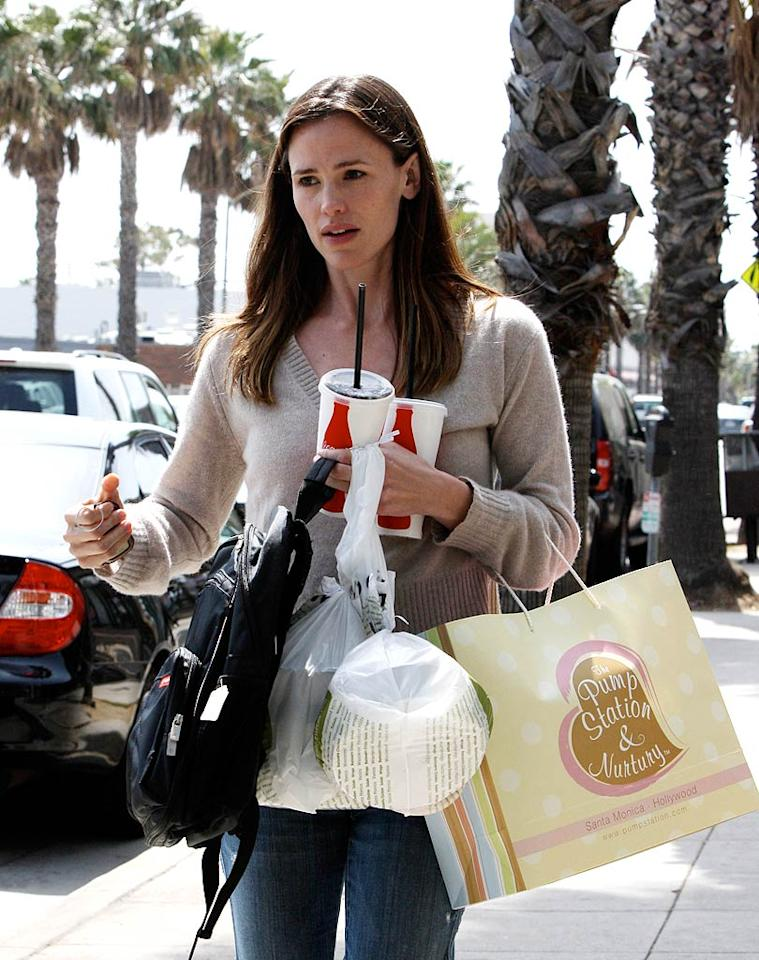 """Is Jennifer Garner Pregnant?"" asks the site HollywoodLife. Well, after what must've been an excruciating coin toss, the website concludes, ""Either Jennifer's about four months pregnant with baby #3 ... or she's wearing a very unflattering gray sweater!"" Wait, the choice is either Garner's expecting or that she made a fashion faux pas?! Check out <a href=""http://www.gossipcop.com/jennifer-garner-not-pregnant/"">Gossip Cop</a> to see what someone close to her tells us about her bump. <a href=""http://www.splashnewsonline.com"" target=""new"">Splash News</a> - March 4, 2010"