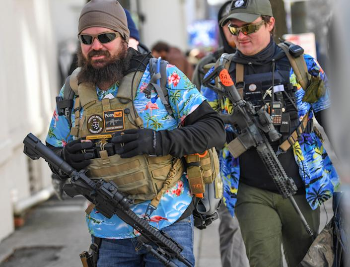 Gun rights advocates and unauthorized militia members gather in Virginia's capitol to protest potential gun control bills. A circuit court judge upheld Gov. Ralph Northam's temporary ban on firearms in Capitol Square.