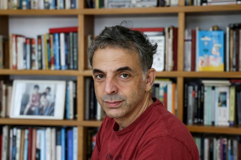 Israeli writer and artist Etgar Keret poses for a photo during an interview with AFP at his home in Tel Aviv on November 5, 2020