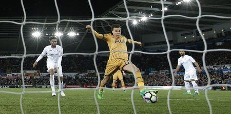 Tottenham's Dele Alli scores their first goal