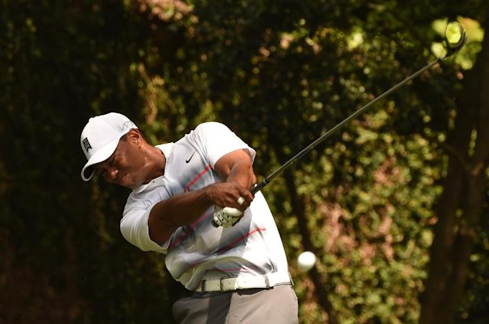 Tiger Woods of the US tees off during Round 1 of the 79th Masters Golf Tournament at Augusta National Golf Club on April 9, 2015, in Augusta, Georgia (AFP Photo/Timothy A. Clary)