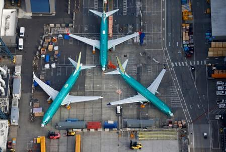 FILE PHOTO: A photo of Boeing 737 MAX airplanes parked on the tarmac at the Boeing Factory in Renton